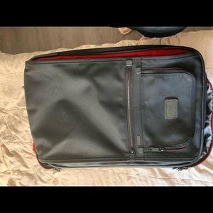 Tumi 22 inch suitcase